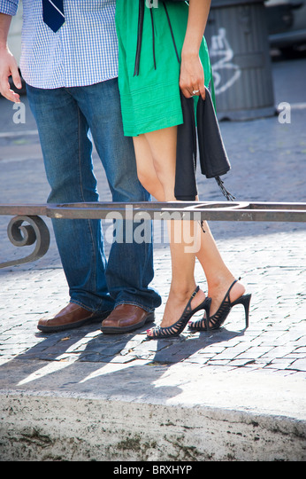 Couple together visiting the city of Rome in Italy - Stock Image