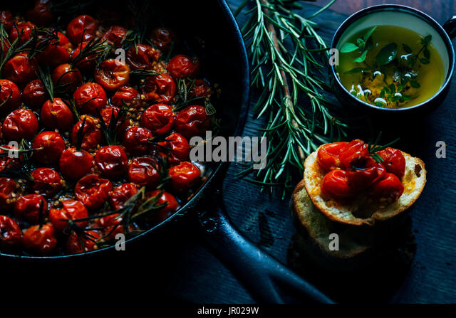 cherry tomatoes with rosemary - Stock Image