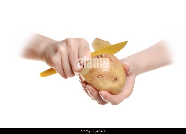 Peeling a potato - Stock Image