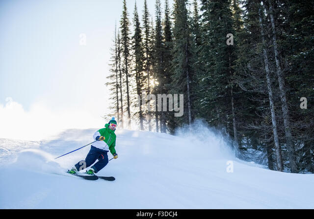 Man skiing downhill - Stock-Bilder