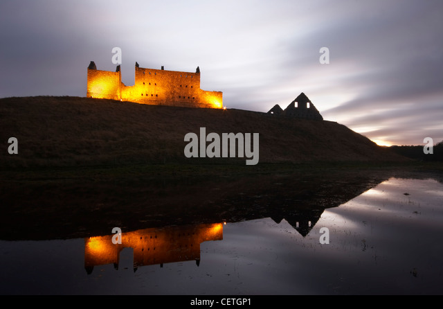 Ruthven Barracks at dusk. The castle that once stood on the site of the barracks, was said to be haunted by its - Stock Image