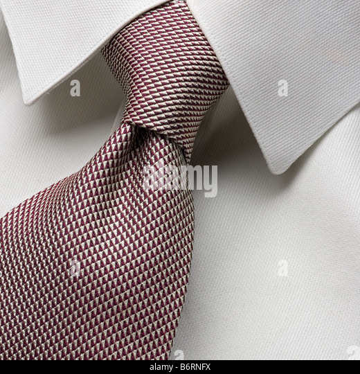 a two in hand knot on a white shirt - Stock Image
