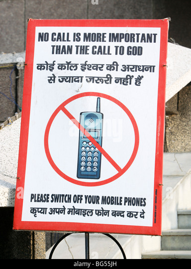 Sign before a church says 'mobile phones off please. India - Stock-Bilder