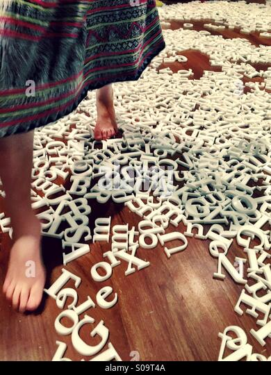 Walking on words - Stock Image