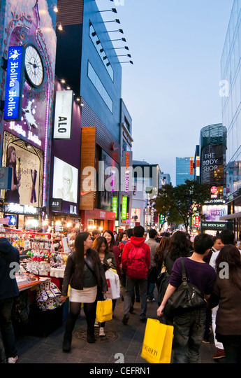 Crowded street in the evening in the popular shopping district of Myeongdong in Seoul, Korea - Stock Image