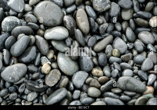 PEBBLES ON A BEACH - Stock Image