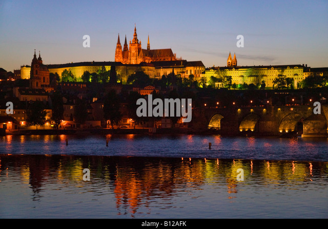 Night view of Charles Bridge by Vltava River with Prague Castle in the distance Prague Czech Republic - Stock-Bilder