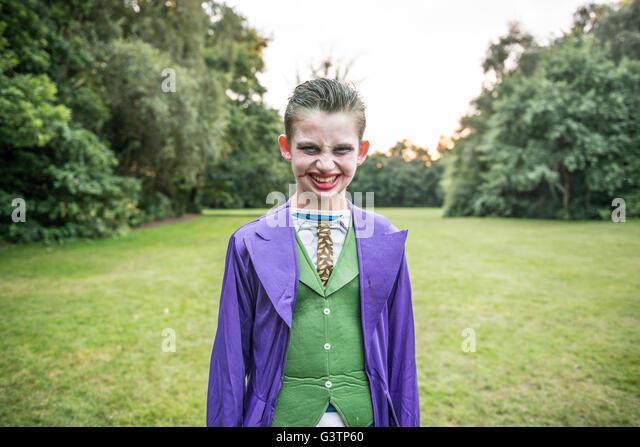 A boy dressed as The Joker for Halloween Night. - Stock-Bilder