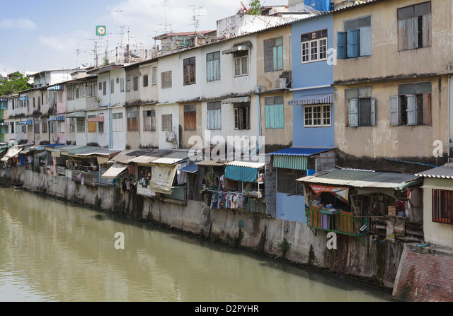 Flats and apartments by the canal, Banglamphu, Bangkok, Thailand, Southeast Asia, Asia - Stock Image
