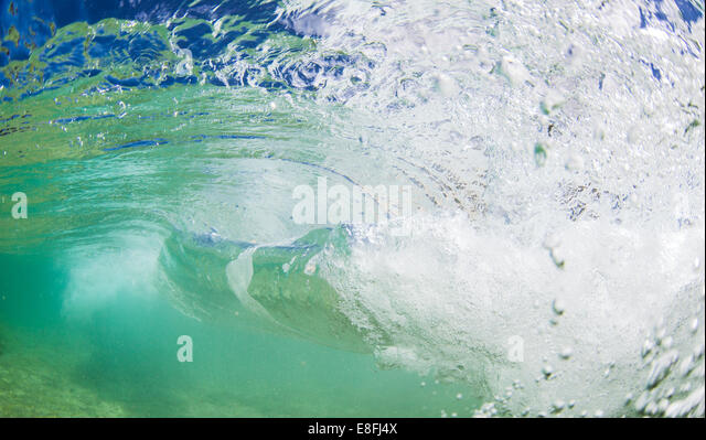 Close-up of ocean wave breaking - Stock Image