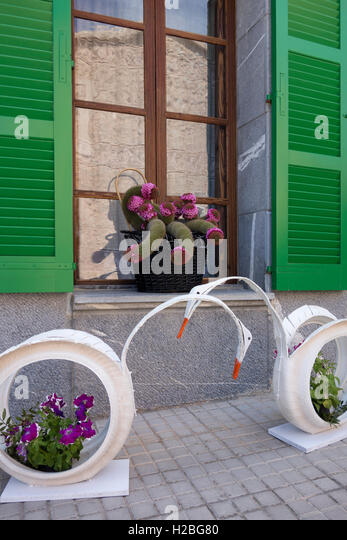 Recycled tires used as flower pots. - Stock Image