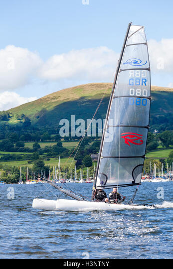 The English Lake District - Sailing a catamaran on Ullswater, Cumbria UK - Stock Image
