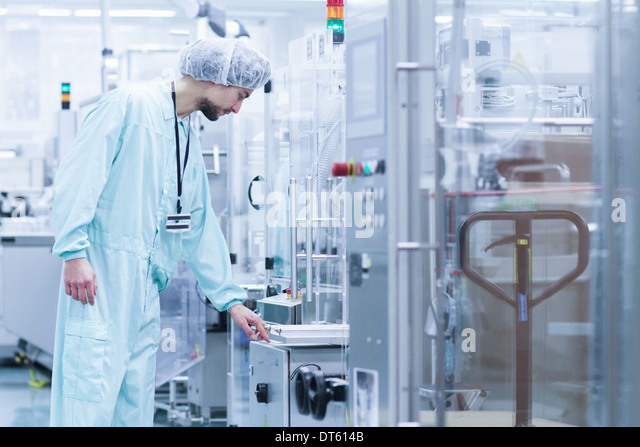 Laboratory technician checking the process - Stock Image