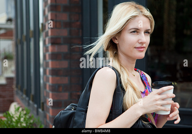 Woman with coffee to go - Stock-Bilder