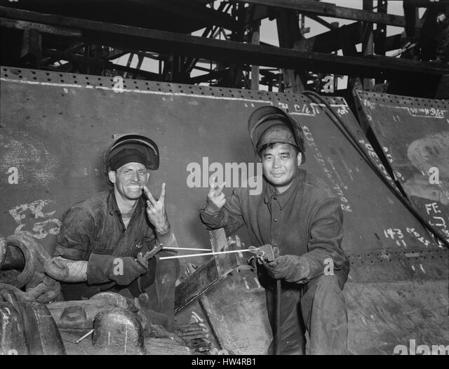 LIBERTY SHIPS  Two electric welders working on the Liberty class cargo ship USS Frederick Douglass in at the Bethlehem - Stock-Bilder