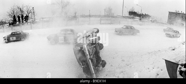 A car turned upside down during a race in the hippodrome covered with snow - Stock Image