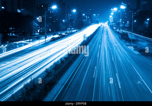 light trails with blue tone - Stock Image