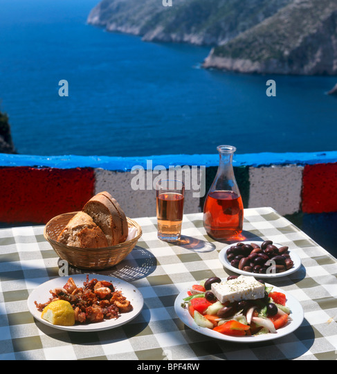 Greek food and wine at a taverna in Kambi, Zakynthos (Zante), Ionian Islands, Greece - Stock Image