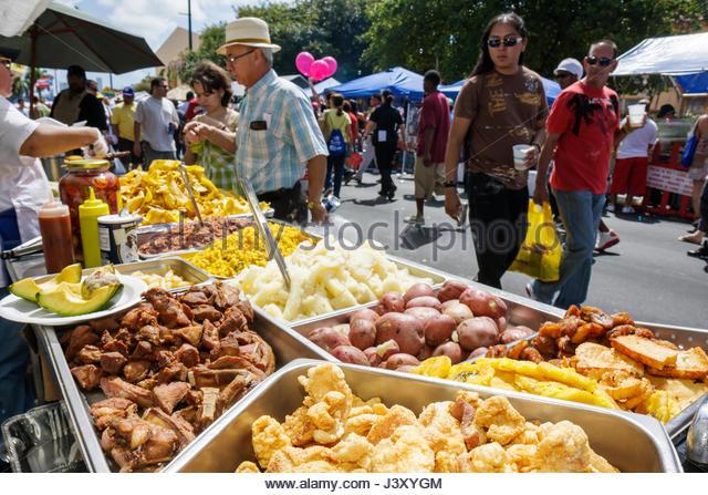 Miami Florida Little Havana Calle Ocho annual event festival street fair Hispanic food outdoor vendor seller sell - Stock Image