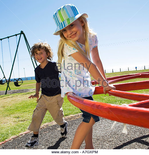 Two young children on a playground - Stock Image