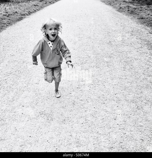 Child running towards you, screaming - Stock-Bilder