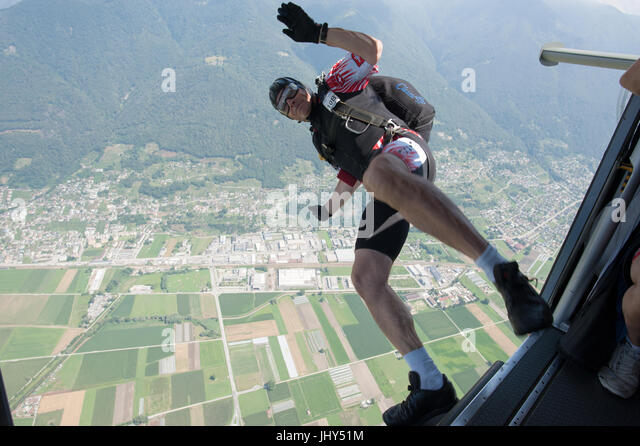 Skydiver enjoying the exit from the plane for an accuracy jump - Stock Image