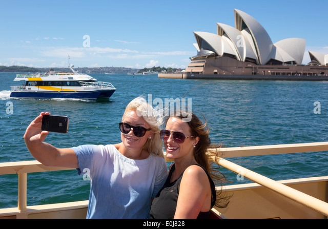 Sydney Australia NSW New South Wales Sydney Ferries Harbour harbor Opera House ferry upper deck riders passengers - Stock Image