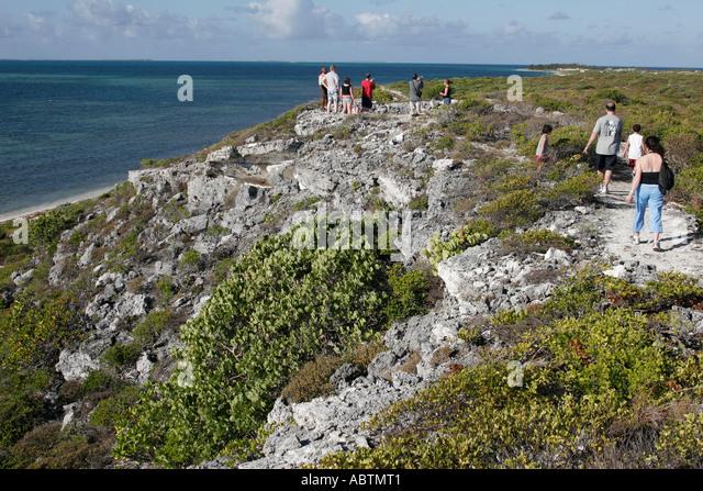 Grand Turk Atlantic Ocean Hawknest Plantation Gun Hill dune buggy excursion tour rocky trail hikers - Stock Image