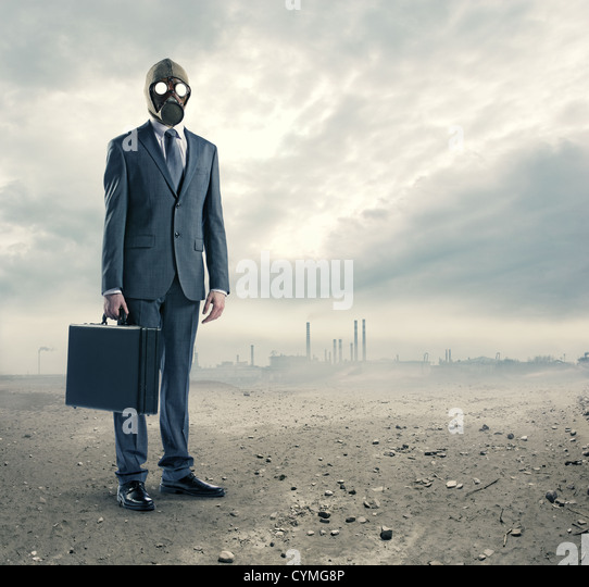 pollution concept: portrait of businessman in a gas mask  with suitcase - Stock-Bilder