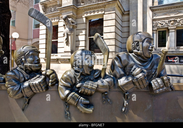 Our Game sculpture in front of Hockey Hall of Fame, Front Street, Toronto, Ontario, Canada - Stock Image