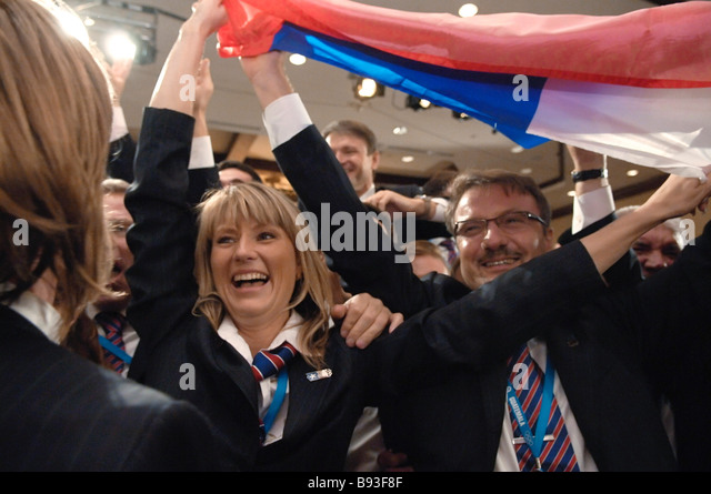 Celebrating victory in Guatemala after the International Olympic Committee decided to hold the 2014 Winter Olympics - Stock Image