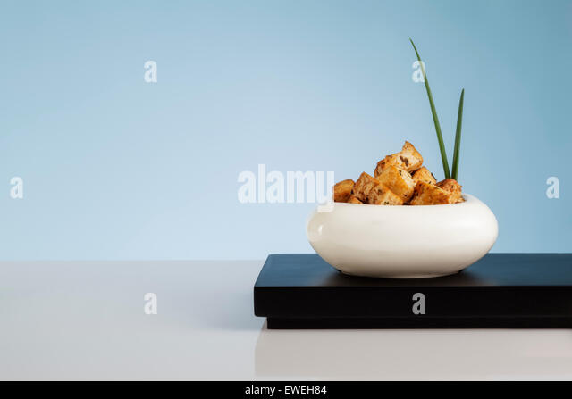 Spiced Tofu Cubes garnished with Chives - Stock Image