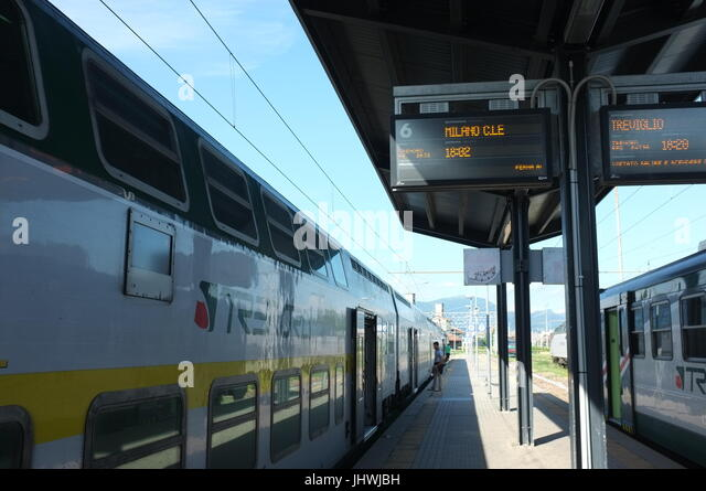 The Trenord train to Milan on platform six at Bergamo railway station, Bergamo, Lombardy, northern Italy, July 2017 - Stock Image