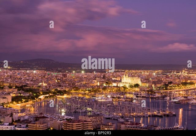 View of the harbour at dusk from Castell de Bellver, Palma, Mallorca, Balearic Islands, Spain, Europe - Stock Image