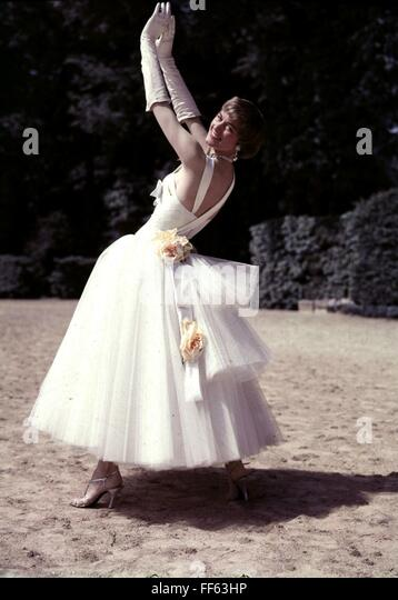 fashion, 1950s, ladies' fashion, woman wearing white dress decorated with flowers, - Stock Image