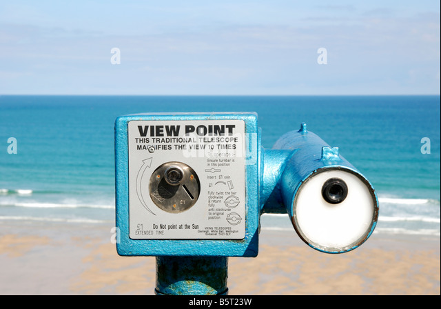 a seaside telescope overlooking a beach at newquay in cornwall,uk - Stock Image