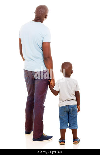 rear view of young African man with his son isolated on white background - Stock Image
