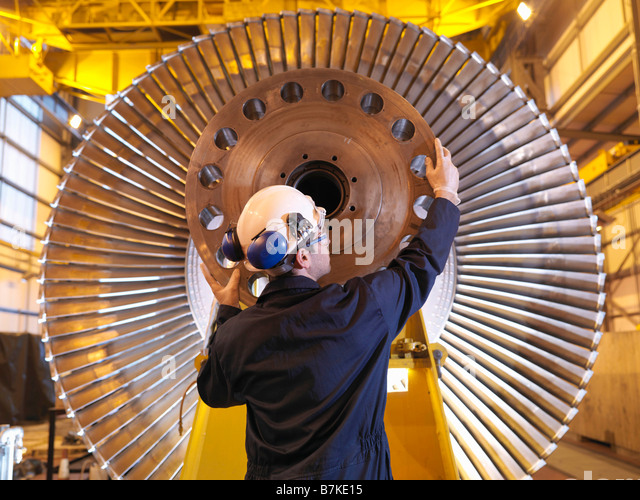 Engineer Inspecting Turbine - Stock Image