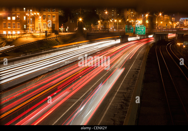 Streaks of lights of moving vehicles on the road, Mass Turnpike, Boston, Massachusetts, USA - Stock Image