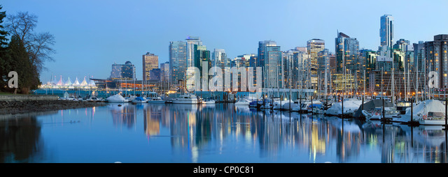 Vancouver BC City Skyline along False Creek by Stanley Park at Blue Hour - Stock Image