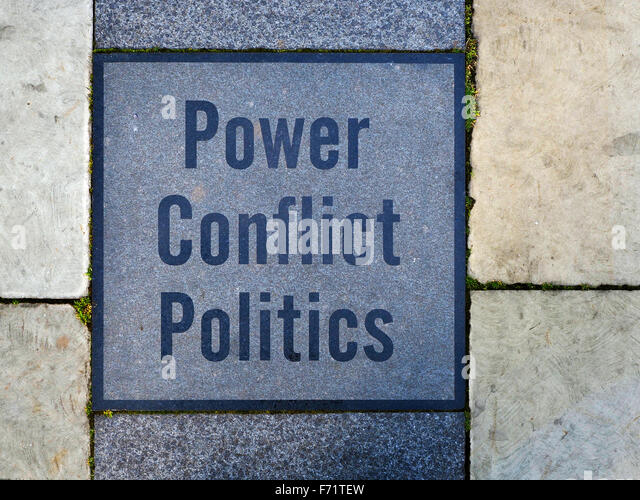 Power Conflict Politics Inscription in Armouries Square Leeds West Yorkshire England - Stock Image