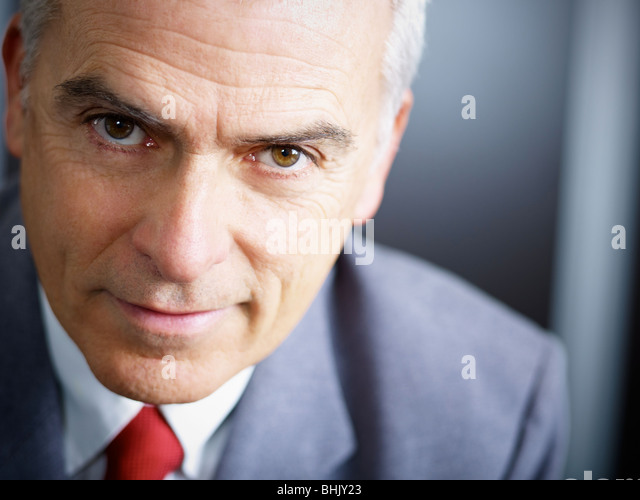 closeup of mature business man looking at camera. Copy space - Stock Image