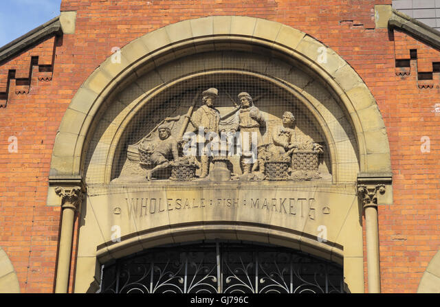 Smithfield old fish Markets sculpted figures,Manchester city centre, England,UK - Stock Image