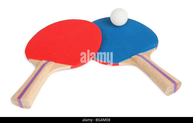 This is an isolated close-up of two table tennis rackets and one ball. - Stock Image