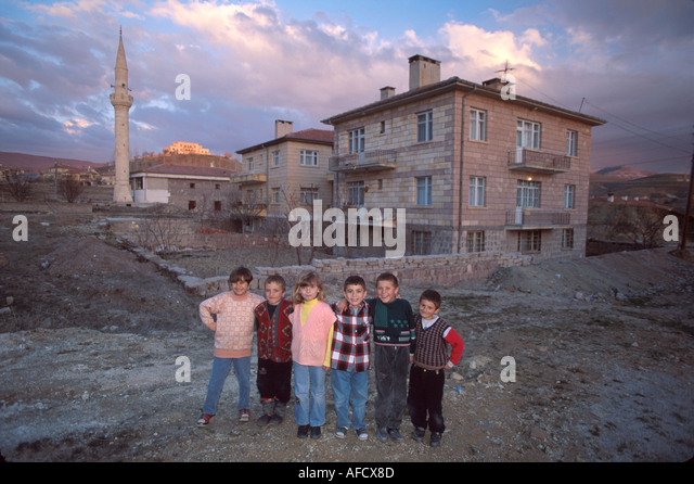 Turkey Cappadocia Urgup kids apartment complex mosque - Stock Image