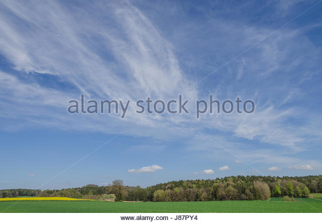 The most common form of high-level clouds are thin and often wispy cirrus clouds. Typically found at heights greater - Stock Image