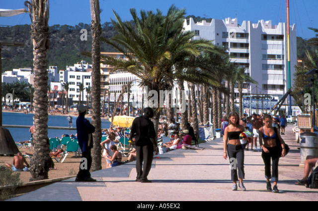 spain Ibiza balearic island San Antonio Paseo Maritimo people Promenade - Stock Image