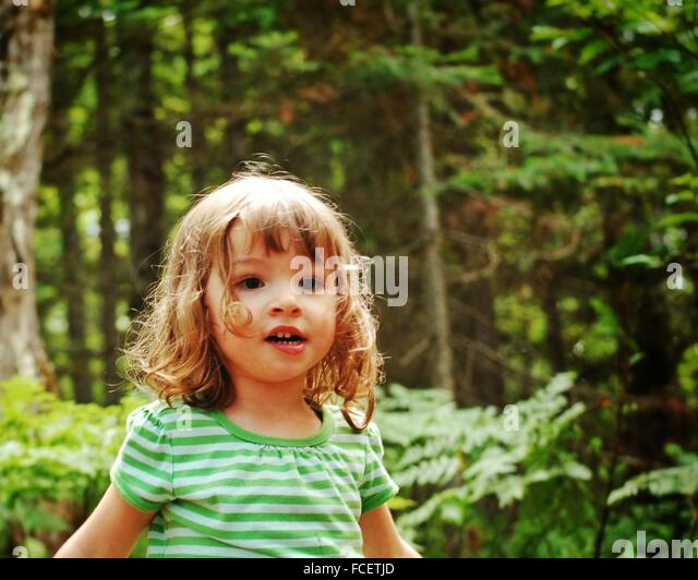 Cute Girl In Forest - Stock Image