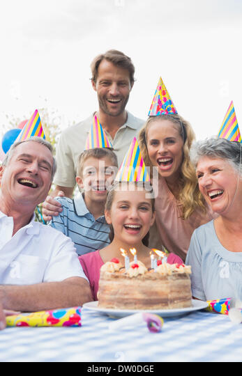 Happy extended family celebrating a birthday - Stock Image