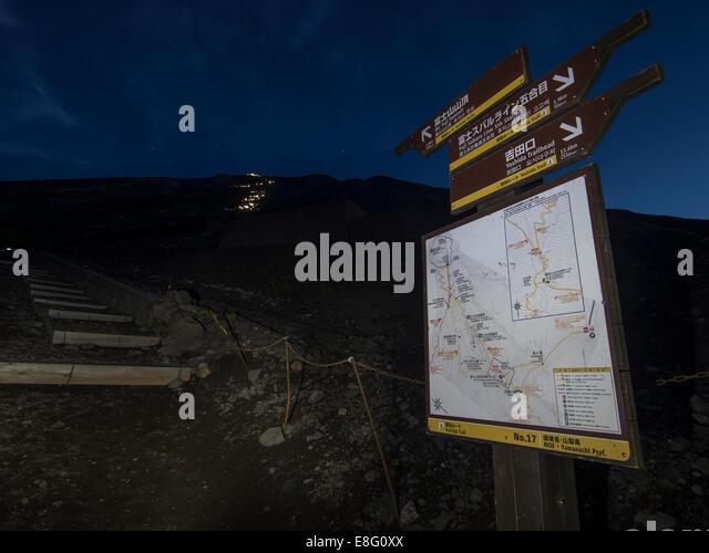 Climbing Mt. Fuji, JAPAN - Direction sign on Fuji Subaru Line ( Yoshida Trail ) Night climb - Stock Image